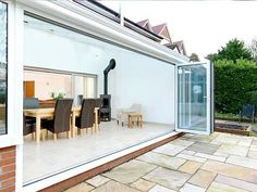 When you choose an aluminium conservatory, particularly when combined with sliding bi-folding doors, can give your home a feeling of contemporary style. Conservatory Prices, Modern Conservatory, Conservatories For Sale, Glass Extension, Extension Ideas, Folding Doors, House Extensions, Contemporary Style, Range
