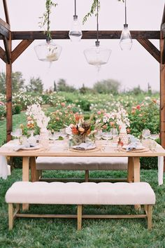 An open-air greenhouse filled with flowers and custom lighting. Photo: @wisteriaphotography Garden Wedding Dresses, Wedding Flowers, Green Wedding, Wooden Greenhouses, Alternative Bouquet, Wedding Dress Boutiques, Ceremony Arch, Elegant Bride, Romantic Roses