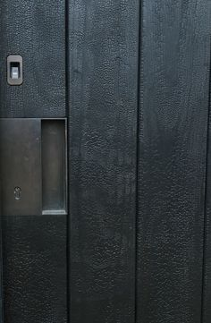 Full gator Shou Sugi ban timber entrance door with bronze recessed handle, bronze biometric entry with digital lock by The Cave architecture and design Flush Door Design, Detail Architecture, Garage Door Lock, Charred Wood, Design Exterior, Timber Cladding, Timber Wood, Bedroom Doors, Entrance Doors