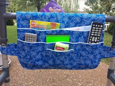 This walker organizer bag is sized to fit standard and larger walkers. It drapes easily over horizontal bar with lots of pockets for easy to reach items such as; handheld phone, reading glasses, iPad, TV remote, meds, writing pads and pens, magazines, tissues, needlework, and such. FEATURES * Made of 100% premium cotton that features white floral images on bright blue background * All pockets fully lined, interfaced and trimmed in white piping to ease location of slip pocket openings…