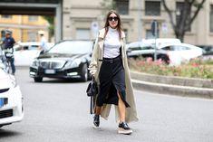 """How To Dress Like An Italian Girl — 50+ Lessons Worth Knowing #refinery29  http://www.refinery29.com/2014/09/74945/milan-fashion-week-2014-street-style#slide26  Crisp, neutral separates that are anything but """"safe."""""""