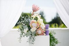 King proteas and greenery arranged by Fleur le Cordeur | Photo by Tasha Seccombe