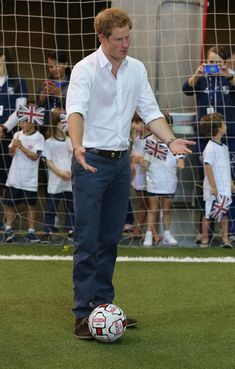 Prince Harry plays football with young school children during a visit to Minas Tenis Clube on the second day of his tour of Brazil on June 24, 2014 in Belo Horizonte,