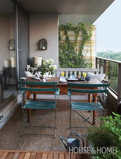 Eclectic Dining Area Small slatted chairs arent too stuffy for a small balcony Pair pieces with different styles for a setting that looks inviting and charming as oppos. Porch And Balcony, Outdoor Balcony, Outdoor Spaces, Balcony Gardening, Balcony Ideas, French Balcony, Balcony Table And Chairs, Small Porches, Small Patio