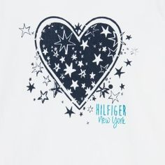 Girls ivory long-sleeved Tommy Hilfiger t-shirt with a black heart and stars printed on the front. Made in a soft cotton jersey, with a round neckline and a shiny blue glitter logo on the front.