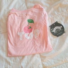 Dollskill Cherry on Top pink tee. Oversized, NWT. Super girly and cute. Bit too big on me ): Not Nasty Gal, there's just no way to select the actual brand or Dollskill as a distributor. Nasty Gal Tops Tees - Short Sleeve