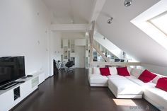 Completely reconstructed furnished split-level attic flat with air-conditioning and a 50 terrace, situated on the fifth top floor of a corner building from the early centu. Prague, Showroom, Apartments, Terrace, Couch, Flooring, Bedroom, Building, Furniture