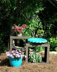 My garden recycle project!   I painted the washer and dryer bases with hammered spray paint.   I painted a bird bath bowl and old pot for a pop of color... then just added potting soil and some flowers. My 10 year old washer and dryer died this summer and these bases were left in the garage just taking up space!