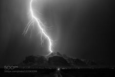 Thor's Landing - Pinned by Mak Khalaf An early morning thunderstorm over the Superstition Mountains on July 3rd delivered a couple of magical lightning strikes. This one in particular is one of my favorites...a single powerful bolt landing at almost the highest point of the mountain. I'm a huge comic book fan and if anything looked like the arrival of Thor from Asgard this is it. Landscapes thunderstorm20150703Canon 5D Mark IIIapache junctionarizonablack & whitecanon 50mm 1.2city…