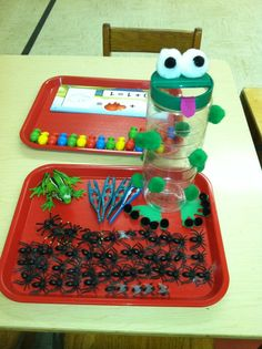 Parm. cheese container- hot glued white pom poms on for eyes- with black pom poms inside- felt tounge- this was a huge hit with the preschoolers- taking tweezers to feed the frog plastic flys and spiders