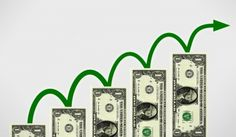 Free Photo of Dollars with jumping arrow - Money growth concept
