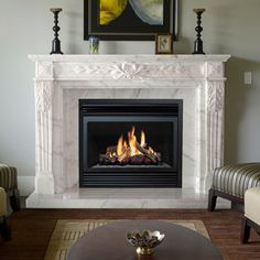 Also, a fireplace can be well decorated using some ideas, one of them is marble fireplace surrounds. Surrounding your fireplace with marble will add more . Marble Fireplace Surround, Fireplace Mantel Surrounds, Stone Mantel, Marble Fireplaces, Fireplace Mantle, Fireplace Design, Linear Fireplace, Fireplace Modern, Mantel Shelf