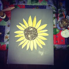 So easy. Just paint/trace a flower on canvas and put glitter in the middle with mod podge :) did it for my apartment & only for $7!