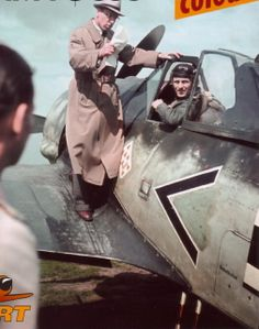 Oberingenieur Rudolf Blaser on the wing of a Focke-Wulf Fw 190 A-2 bearing the tactical marking < + I. This aircraft, Wernummer 20206, was flown by Oberfeldwebel Walter Grünlinger, wingman of the Gruppenkommandeur Hauptmann Josef Priller. Grünlinger had apparently just returned from a combat mission when this photograph was taken, and Blaser is seen explaining some technical aspects of the aircraft