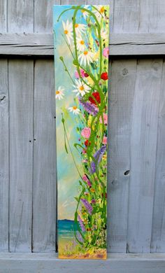 A long slim canvas, perfect for many spaces in a home. **Although this is photographed outside, this is a painting for indoors** Sunshine, sand,sea,sky Painted with acrylic paint and varnished fo...