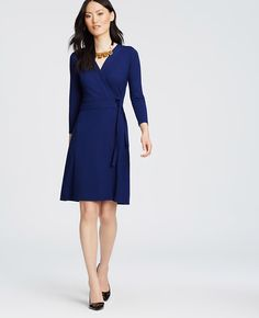 """Meet our iconic wrap dress: the won't quit wonder that fits and flatters all. Trapunto stitched V-neck with crossover front. 3/4 sleeves. Trapunto stitched waistband with belt ties. 20"""" from natural waist."""