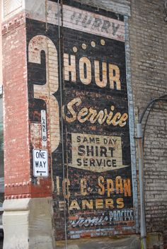 Laundry sign -I love the vintage ads painted on brick walls!