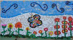 Mural sobre tema primavera realitzat íntegrament amb taps d'ampolla.