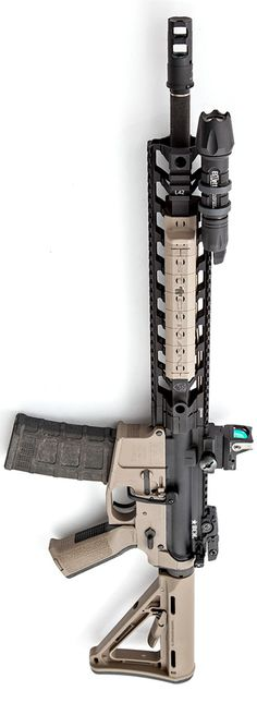 Fortis rail with a SureFire MB556K muzzle brake on a Bravo Company upper, Elzetta light and mount, Trijicon RMR, with Magpul attire. By Stickman.