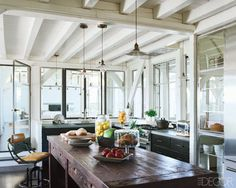 love the space, the light, the beams, THE WOODEN ISLAND!  beautiful!