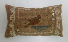 Bird cross stitch pillow ornament with pretty lace trim