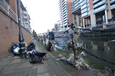 River Irwell flooding: Pictures that show it's still a mess after deluge dragged branches, sludge and rubbish onto banks - Manchester Evening News