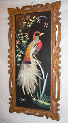 Very nice condition vintage 60s Mexican feather art painting. Even has the story on the back label.  Picture measures 8x16,nice carved wood