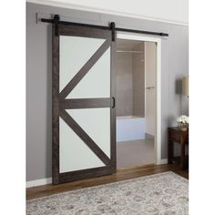 Found it at Wayfair - Continental Frosted Glass 1 Panel Ironage Laminate Interior Barn Door