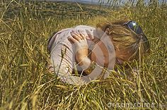 A young woman in a spring wheat field