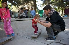 Meet the Skater Girls of Afghanistan - Skateistan's founder and executive director Oliver Percovich with possibly the youngest girl skateboarder in Afghanistan. Photo courtesy of Skateistan, via PBS Newshour.