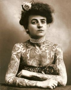 lomographicsociety:  Female Tattoo Artist of the 1910's Introducing the first known female tattoo artist in America. Maud Wagner was the first known female tattoo artist in the United States. Little is known about this awesome vintage lady, however according to The New Yorker, Maud traded a date with her husband-to-be Gus Wagner in 1907 for tattoo lessons. Now that's impressive!