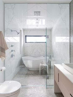 contemporary wet room, parallel shower & free standing bathtub, tile floors, marble walls