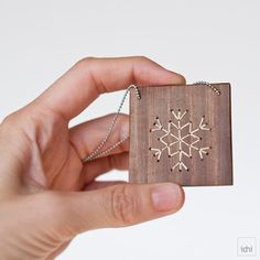 Snowflake · Pendant of square wooden with embroidered snowflake silhouette  · white color ·