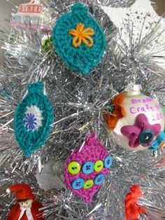 Make and embellish tree ornaments--easy crochet instructions.  Could also be strung together with chained yarn or ribbon to make a garland for the tree or mantle.