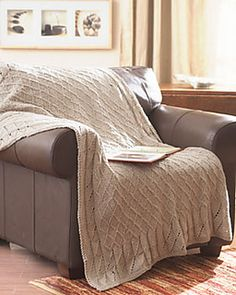 A subtle criss-cross pattern makes this afghan an elegant and sophisticated addition to any room. Shown in Waverly for Bernat. (Bernat.com)