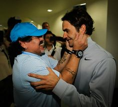 Football (Soccer) legend Diego Armando Maradona is very excited to meet Roger Federer! What do you think Federer is thinking?