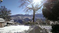 Busana sotto la Neve. Sullo sfondo la catena degli Appennini