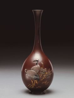 Vase with cranes and flowers, Iron with gold, silver,shakudo, and shibunchi by Isshin. A 19th century artist, Isshin worked out of Tokyo, Japan #Japaneseart #Pottery #Crowcollection