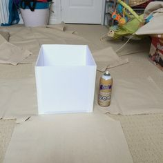 Gluing the fabric to the storage boxes - northstory.ca