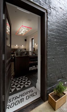 Patricia coffeeshop, Melbourne (hexagon and triangle flooring + neon sign hanging from ceiling)