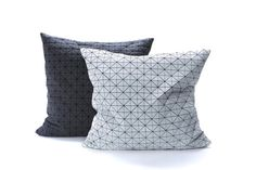 Two Origami Pillow Covers that has a textured, geometric pattern that goes beyond standard two dimensionality into a unique, shape-making surface. These