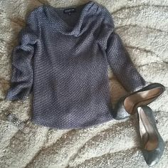 Jones New York Sweater An elegant knitted silver/gray long sleeve sweater. Goes well with a pair of jeans or a nice black skirt. It is lightly worn. Jones New York Sweaters