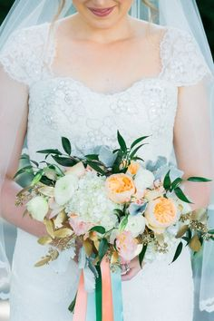 Peach, blues and cream blooms | Photography: Dabble Me This - dabblemethis.com/  Read More: http://www.stylemepretty.com/2015/05/22/enchanting-chicago-wedding-at-revolution-brewing/