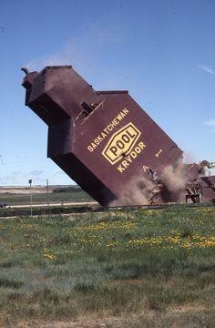Demolishing a grain silo, Krydor, Sasketchewan, Canada, 1980, photograph by Hans S. Dommasch.