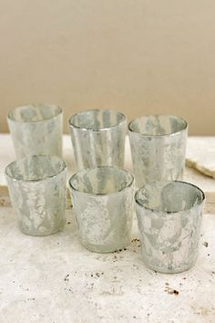 9.00 SALE PRICE!        Give your tables a warm metallic glow with this set of six Silver Frost Votive Holders. These candle holders have a semi-translucent ...