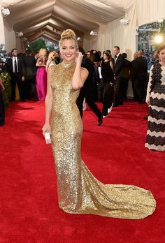 Kate Hudson. Kate glowed in a golden Michael Kors gown.