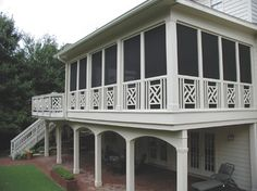 Decorative rails highlight this screen porch design.  Hands-down!