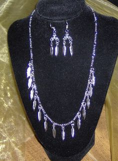 Jewelry / Necklace and Earrings / Handmade / Silver feathers   $30.00