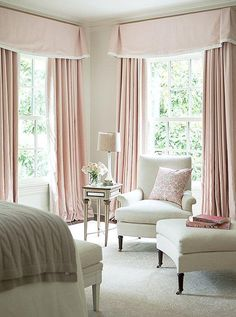 Inside Suzanne Kaslers Stunningly Serene Atlanta Home  -- Sophisticated soft pale pink bedroom with floor to ceiling pink shaded curtains, blush pillow, cream chair, ottoman and bench at the foot of the bed, with a cozy cable cashmere throw blanket on the white bed. For more sophisticated traditional interior design ideas, see the full home tour on our Style Guide!