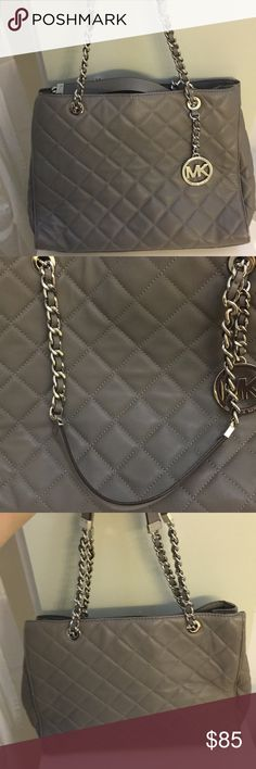 Gray quilted leather Michael Kors purse Great condition gray quilted leather Michael kors shoulder bag. Has silver toned hardware. Soft quilted leather. Silver chain strap. Inside zip pocket and separated side compartments. Michael Kors Bags Shoulder Bags